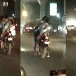 तेज रफ्तार बाइक, फ्यूल टैंक पर लड़की, KISS करते कपल का Video वायरल
